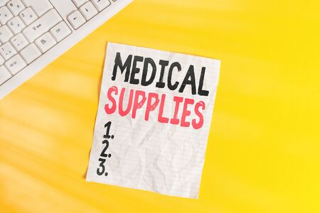 Text sign showing Medical Supplies. Business photo showcasing Items necessary for treatment of illness or injury Copy space on notebook above yellow background with pc keyboard on the table 免版税图像 - 150258861