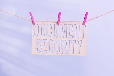 Word writing text Document Security. Business photo showcasing maintenance of security of all of the important archives Clothesline clothespin rectangle shaped paper reminder white wood desk