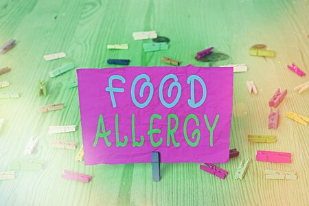Handwriting text writing Food Allergy. Conceptual photo abnormal immune system response to allergen after eaten Colored crumpled rectangle shaped reminder paper light blue background Stock Photo