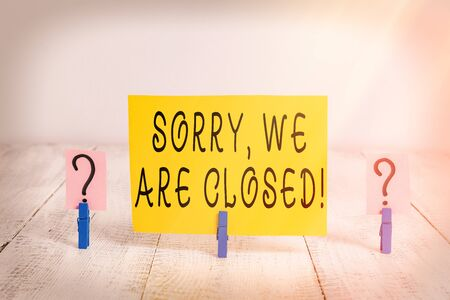Conceptual hand writing showing Sorry, We Are Closed. Concept meaning apologize for shutting off business for specific time Crumbling sheet with paper clips placed on the wooden table