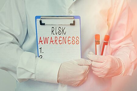 Conceptual hand writing showing Risk Awareness. Concept meaning recognizing factors that may cause a lifethreatening effect Laboratory blood test sample for medical diagnostic analysis