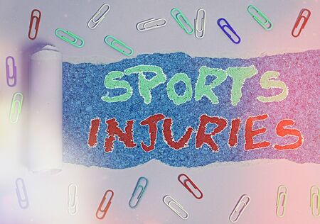 Word writing text Sports Injuries. Business photo showcasing injuries that occur when engaging in sports or exercise Rolled ripped torn cardboard placed above a wooden classic table backdrop