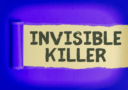 Text sign showing Invisible Killer. Business photo text presence into the air of a substance which are harmful Rolled ripped torn cardboard placed above a wooden classic table backdrop