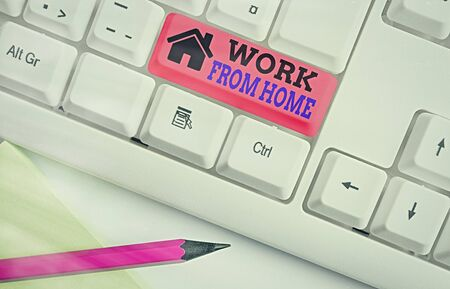Writing note showing Work From Home. Business concept for communicating with the company mainly from home flexibly White pc keyboard with empty note paper above white key copy space Reklamní fotografie