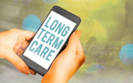 Handwriting text Long Term Care. Conceptual photo assistance with the basic an individualal tasks of everyday life Modern gadgets with white display screen under colorful bokeh background