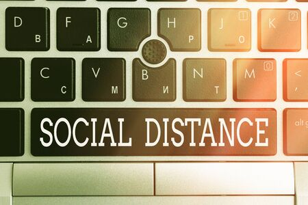 Conceptual hand writing showing Social Distance. Concept meaning degree of acceptance of general interaction of individuals Pc keyboard key with note paper above background copy space
