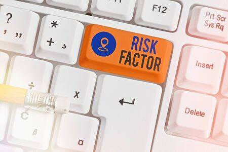 Writing note showing Risk Factor. Business concept for Characteristic that may increase the percentage of acquiring a disease White pc keyboard with empty note paper above white key copy space