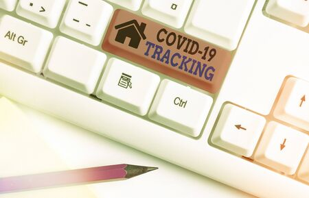 Writing note showing Covid 19 Tracking. Business concept for Distinguishing process of the possible infected individuals White pc keyboard with empty note paper above white key copy space
