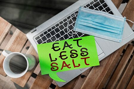 Word writing text Eat Less Salt. Business photo showcasing reducing the sodium intake on the food and beverages Set of medical equipment with notepad for health condition assessment Foto de archivo