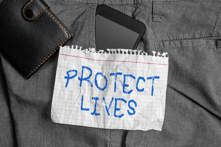 Word writing text Protect Lives. Business photo showcasing to cover or shield from exposure injury damage or destruction Smartphone device inside trousers front pocket with wallet and note paper