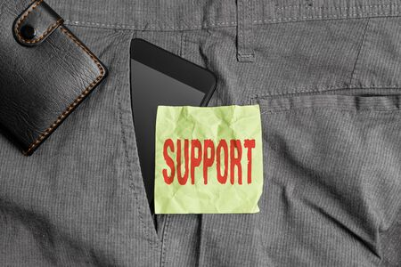 Handwriting text writing Support. Conceptual photo maintain, sustain, uphold all mean to hold up and to preserve Smartphone device inside trousers front pocket with wallet and note paper