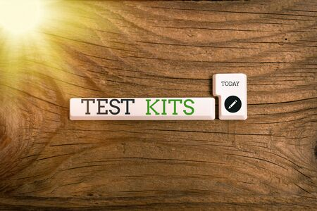 Text sign showing Test Kits. Business photo showcasing tools used to detect the presence of something in the body Pc keyboard key with empty note paper above background copy space