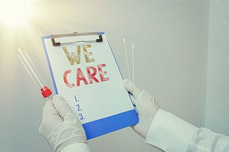 Text sign showing We Care. Business photo showcasing Cherishing someones life Giving care and providing their needs Laboratory blood test sample shown for medical diagnostic analysis result