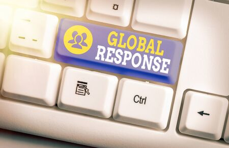 Text sign showing Global Response. Business photo text indicates the behaviour of material away from impact point White pc keyboard with empty note paper above white key copy space