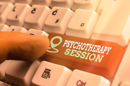Word writing text Psychotherapy Session. Business photo showcasing series of meetings in treating mental health problems White pc keyboard with empty note paper above white key copy space Stockfoto