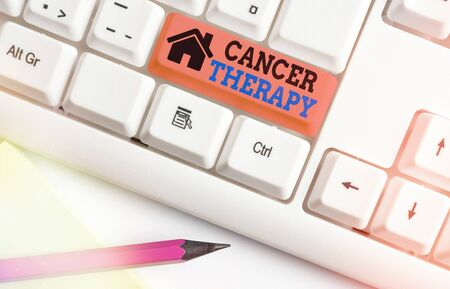 Writing note showing Cancer Therapy. Business concept for the treatment of cancer in a patient often with chemotherapy White pc keyboard with empty note paper above white key copy space Banque d'images