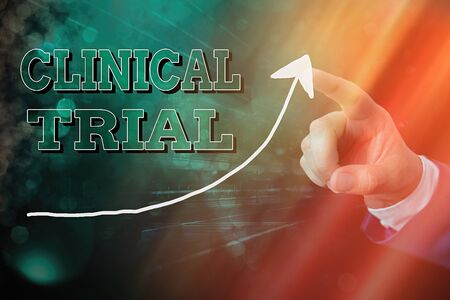 Handwriting text writing Clinical Trial. Conceptual photo evaluate the effectiveness and safety of medications digital arrowhead curve rising upward denoting growth development concept Foto de archivo