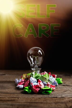 Text sign showing Self Care. Business photo showcasing the practice of taking action to preserve or improve one s is health Realistic colored vintage light bulbs, idea sign solution thinking concept