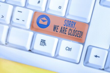 Text sign showing Sorry, We Are Closed. Business photo text apologize for shutting off business for specific time White pc keyboard with empty note paper above white key copy space