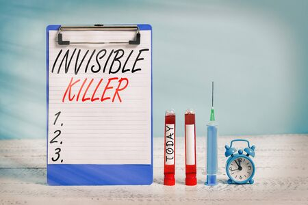 Text sign showing Invisible Killer. Business photo showcasing presence into the air of a substance which are harmful Extracted blood sample vial with medical accessories ready for examination