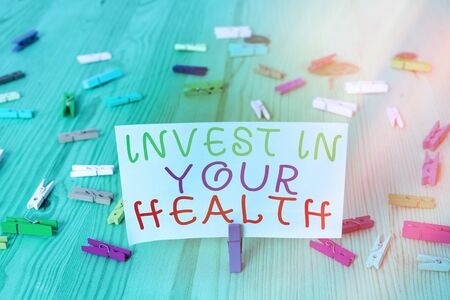 Conceptual hand writing showing Invest In Your Health. Concept meaning put money on maintenance or improvement of your health Colored crumpled rectangle shape paper light blue background