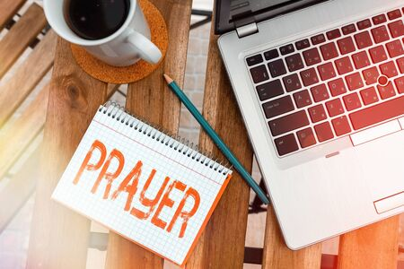Writing note showing Prayer. Business concept for solemn request for help or expression of thanks addressed to God Workplace overview with laptop used for individual interest