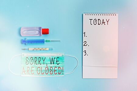Conceptual hand writing showing Sorry, We Are Closed. Concept meaning apologize for shutting off business for specific time Set of medical equipment with notepad for health assessment
