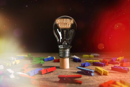 Text sign showing Invisible Killer. Business photo text presence into the air of a substance which are harmful Realistic colored vintage light bulbs, idea sign solution thinking concept Stock Photo