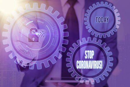 Writing note showing Stop Coronavirus. Business concept for Disease awareness campaign fighting to lessen the COVID19 cases Graphics padlock for web data information security application system