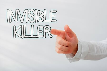 Writing note showing Invisible Killer. Business concept for presence into the air of a substance which are harmful Model with pointing hand finger symbolizing navigation progress growth Stock Photo