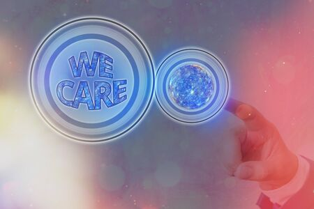 Text sign showing We Care. Business photo showcasing Cherishing someones life Giving care and providing their needs Futuristic icons solar system. 版權商用圖片