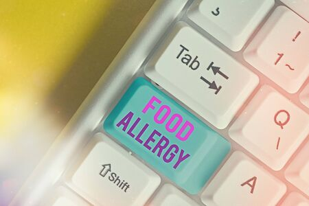 Text sign showing Food Allergy. Business photo showcasing abnormal immune system response to allergen after eaten White pc keyboard with empty note paper above white key copy space