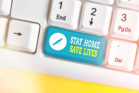 Word writing text Stay Home Save Lives. Business photo showcasing lessen the number of infected patients by not leaving the house White pc keyboard with empty note paper above white key copy space