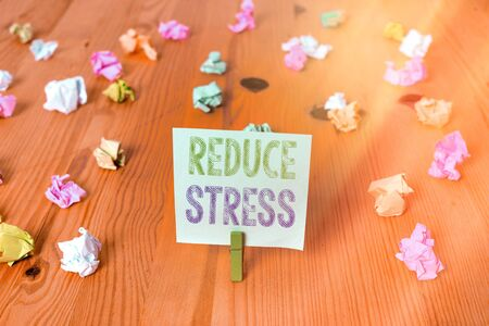 Handwriting text Reduce Stress. Conceptual photo to lessen the state of mental or emotional strain or tension Colored crumpled rectangle shaped reminder paper light blue background Zdjęcie Seryjne