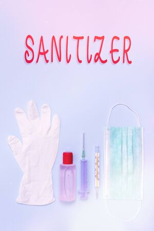 Writing note showing Sanitizer. Business concept for liquid or gel generally used to decrease infectious agents Primary medical precautionary equipments for health care protection
