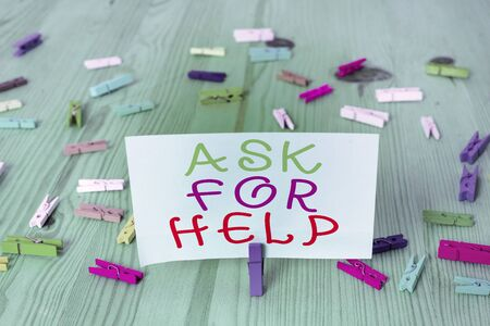 Conceptual hand writing showing Ask For Help. Concept meaning put a question or seek an answer or assistance from someone Colored crumpled rectangle shape paper light blue background Stockfoto