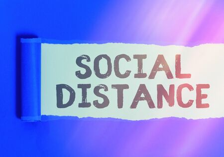 Text sign showing Social Distance. Business photo text degree of acceptance of general interaction of individuals Rolled ripped torn cardboard placed above a wooden classic table backdrop Stockfoto