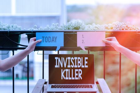 Conceptual hand writing showing Invisible Killer. Concept meaning presence into the air of a substance which are harmful Empty bubble chat sticker mock up emphasizing personal idea Stock Photo