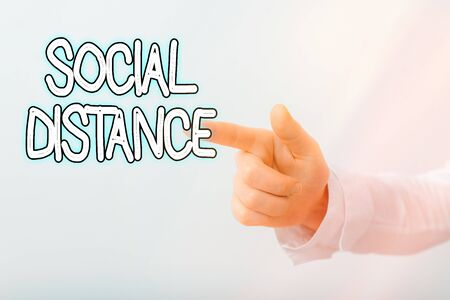 Writing note showing Social Distance. Business concept for degree of acceptance of general interaction of individuals Model with pointing hand finger symbolizing navigation progress growth