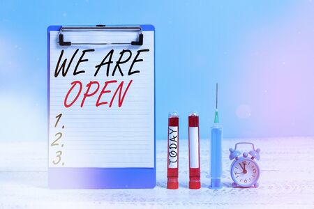 Text sign showing We Are Open. Business photo showcasing no enclosing or confining barrier, accessible on all sides Extracted blood sample vial with medical accessories ready for examination
