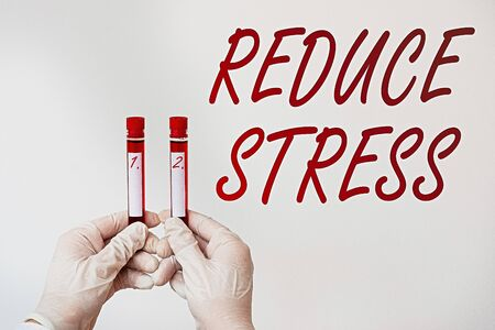 Text sign showing Reduce Stress. Business photo text to lessen the state of mental or emotional strain or tension Extracted blood sample vial ready for medical diagnostic examination