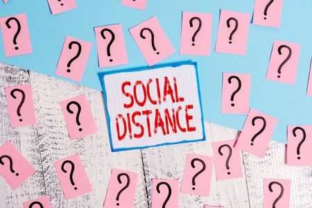 Writing note showing Social Distance. Business concept for degree of acceptance of general interaction of individuals Scribbled and crumbling papers with thick cardboard above wooden table