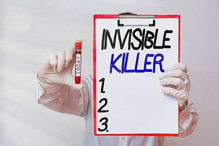Conceptual hand writing showing Invisible Killer. Concept meaning presence into the air of a substance which are harmful Laboratory blood test sample for medical diagnostic analysis
