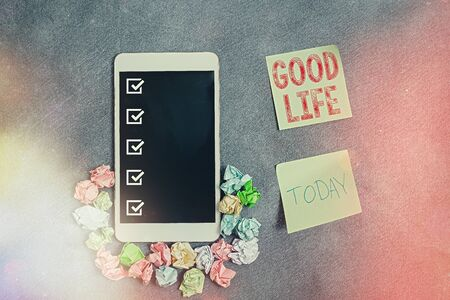 Conceptual hand writing showing Good Life. Concept meaning living in comfort and luxury with few problems or worries Paper accessories with smartphone on different background Zdjęcie Seryjne