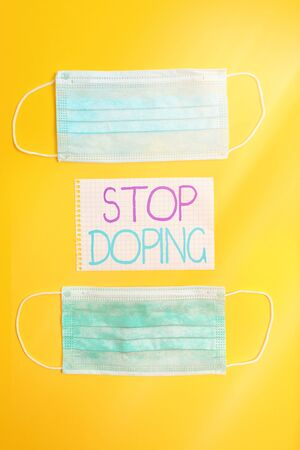 Conceptual hand writing showing Stop Doping. Concept meaning quit the use of banned athletic performanceenhancing drugs Set of medical equipment with notepad for health assessment Foto de archivo