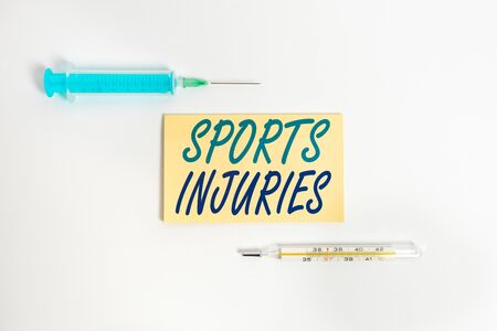 Text sign showing Sports Injuries. Business photo showcasing injuries that occur when engaging in sports or exercise Set of medical equipment with notepad for health condition assessment Banque d'images