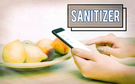 Conceptual hand writing showing Sanitizer. Concept meaning liquid or gel generally used to decrease infectious agents Modern gadgets white screen under colorful bokeh background