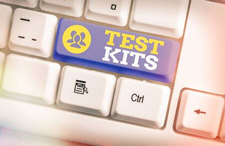 Text sign showing Test Kits. Business photo text tools used to detect the presence of something in the body White pc keyboard with empty note paper above white key copy space
