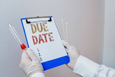 Text sign showing Due Date. Business photo showcasing the day or date by which something is supposed to be done or paid Laboratory blood test sample shown for medical diagnostic analysis result 写真素材