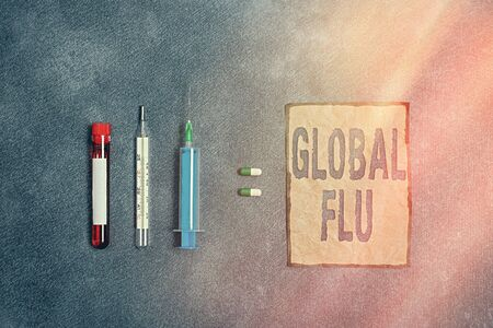 Writing note showing Global Flu. Business concept for Common communicable illness spreading over the worldwide fastly Blood sample vial medical accessories ready for examination